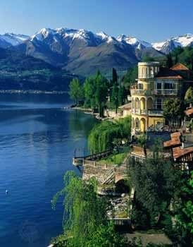 The lake region of Lombardy Italy with a castle and the Alps