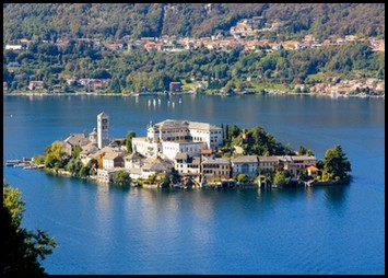 the island Orta San Giulio, Italy surrounded by deep blue water