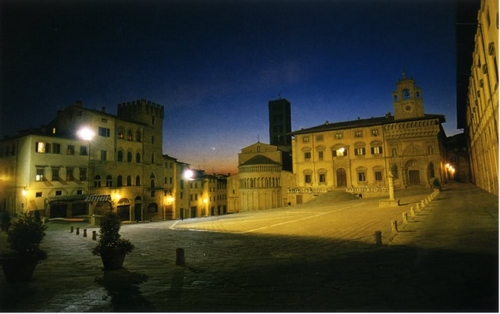 The town square of Arezzo Italy at night