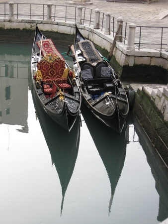 2 gondolas in a side canal in Venice Italy