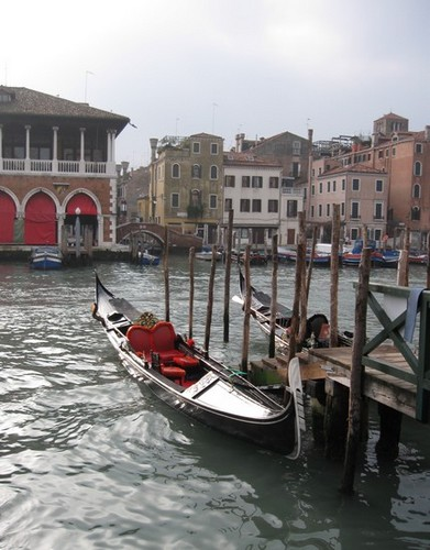 a gondola tied up on a jetty on the grand canal venice