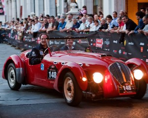 A contestant of the vintage car race Florence to Brescia Mille Miglia