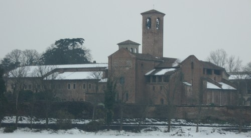 An Italian Abbey with snow on the ground