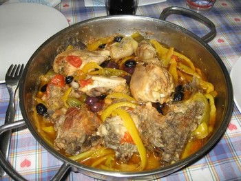 Chicken with peppers and olives.