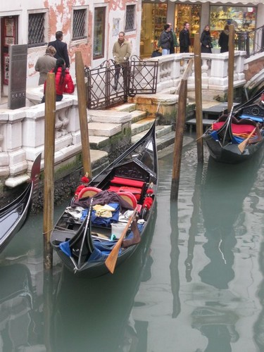 2 gondolas in a canal with refections