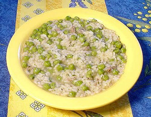 risi e bisi dished up on a yellow plate