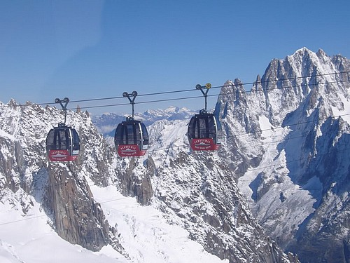 3 cable cars taking people to ski the Aosta valley